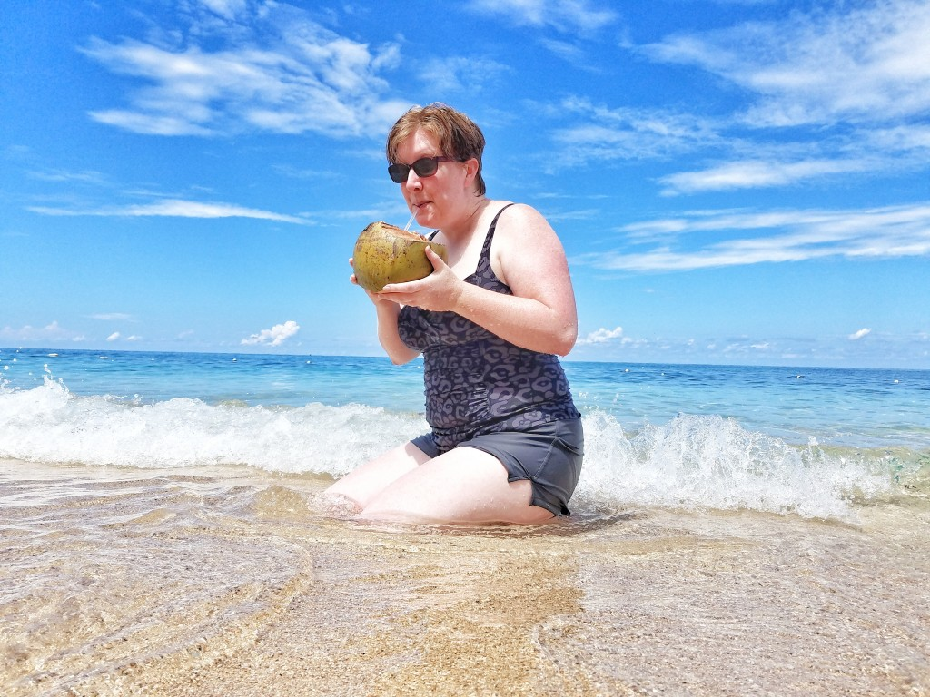 carnival-splendor-ocho-rios-jamaica-bamboo-beach-vip-excursion-wife-drinking-coconut-drink