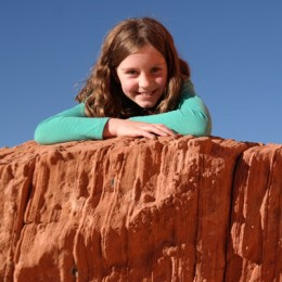 Valley of Fire State Park Daughter Posing on a red cliff
