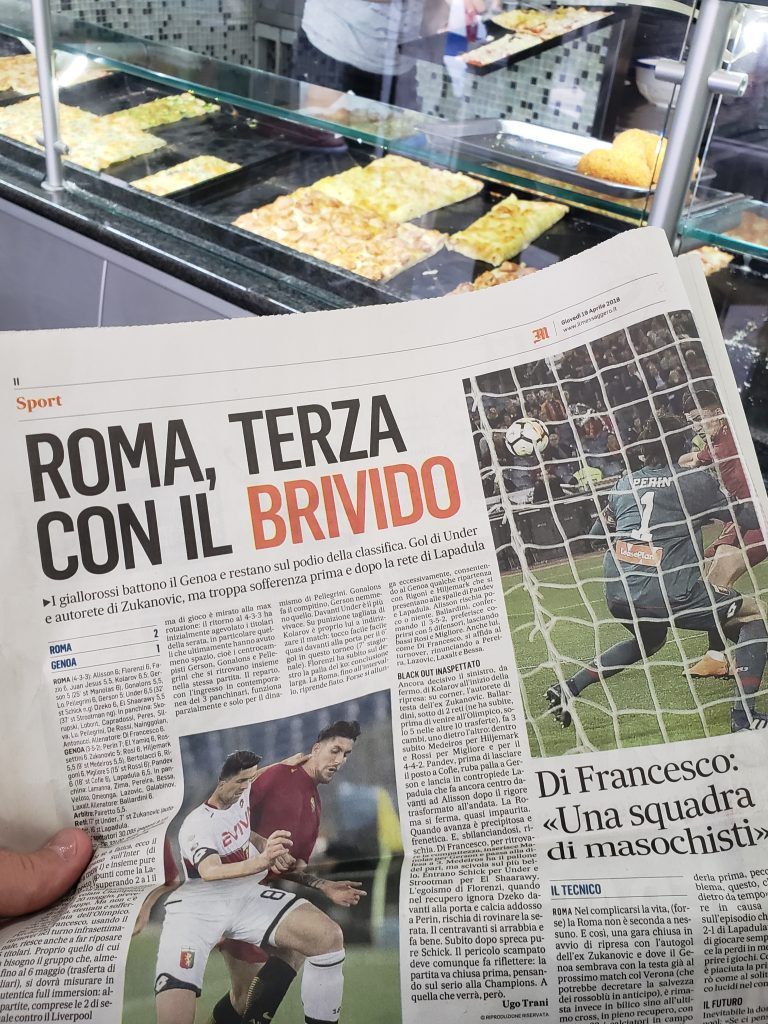 Travel Bucket List Destination Orvieto Italy pizza and newspaper FC Roma