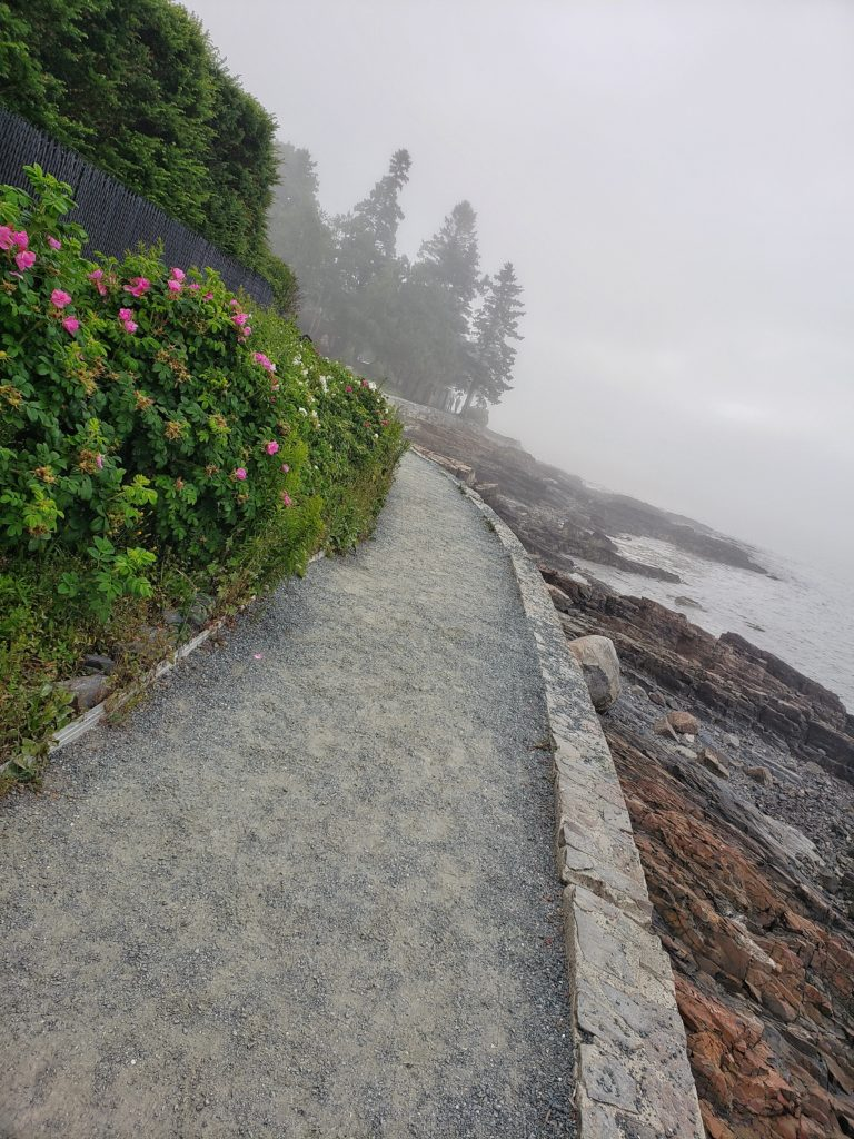 Walking the Shore Path in the fog, in Bar Harbor Maine, along the rugged coast of the Atlantic ocean.