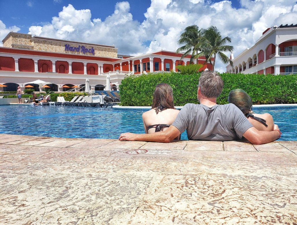 Hard Rock Riviera Maya Rock Royalty Dad and Daughters in the Hacienda Pool